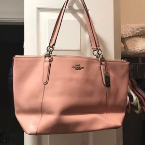 Light pink Coach tote bag with matching wallet